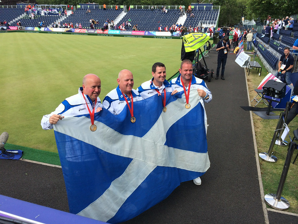 David Peacock, Neil Speirs, Paul Foster and Alex Marshall pose for photos after winning the fours title
